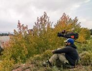 Chilling by the camera and enjoying the Fall colors. It's one of those peaceful moments before the scene starts.